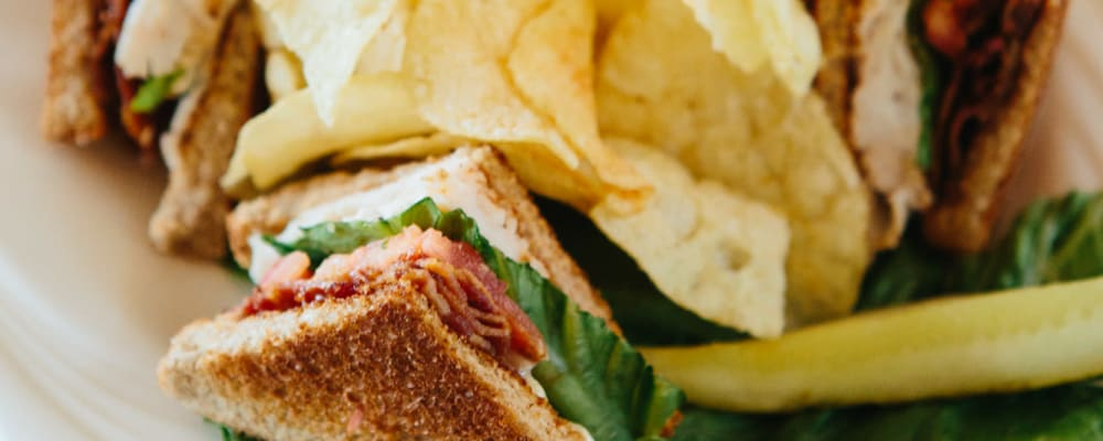 Club sandwich with potato chips at The Springs at Anna Maria in Medford, Oregon
