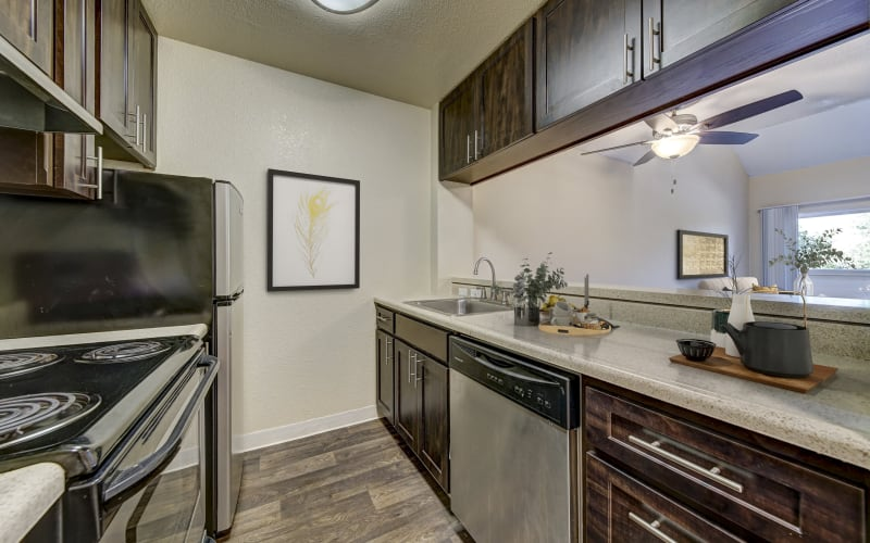 Spacious kitchen with plenty of counter space at The Timbers Apartments in Hayward, California