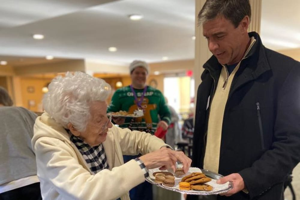 A resident taking some cookies at The Crossings at Bon Air in Richmond, Virginia