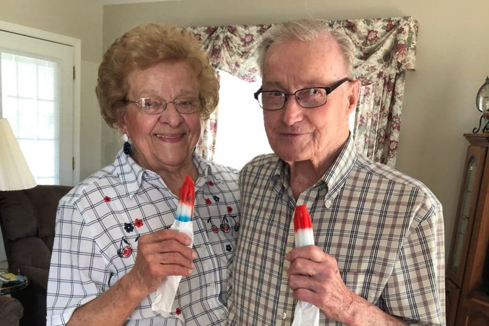 A happy couple eating popsicles in an independent living villa at St. Charles Health Campus in Jasper, Indiana