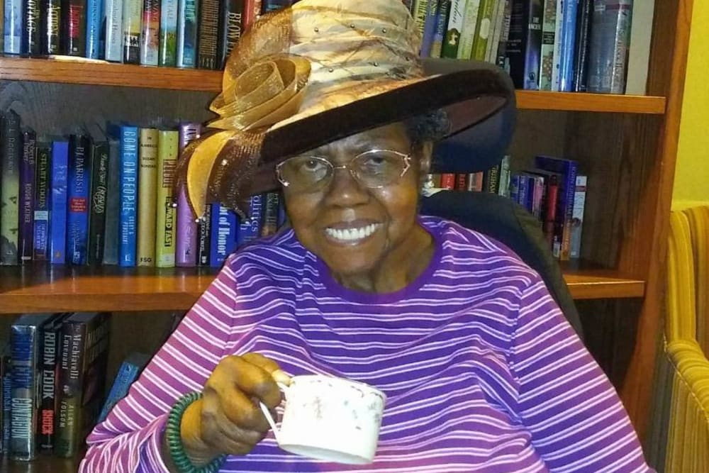 Resident having tea at Victory Centre of Sierra Ridge
