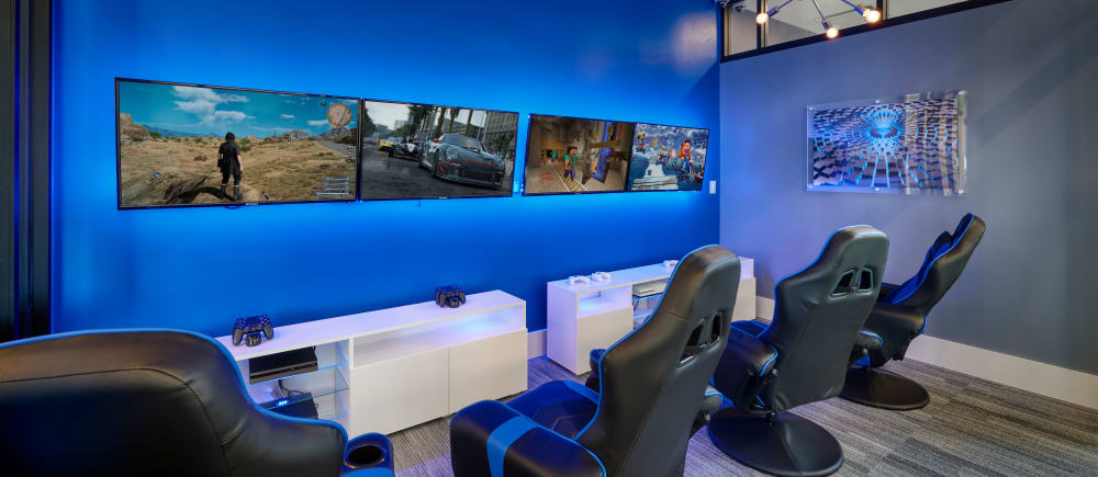 Challenge your friends to a competitive match in the game room at Strata Apartments in Denver, Colorado