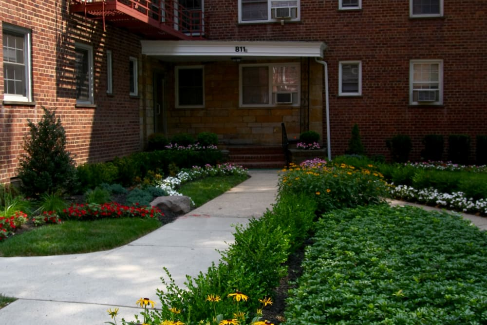 Pretty flower beds along the sidewalks at Linden Arms