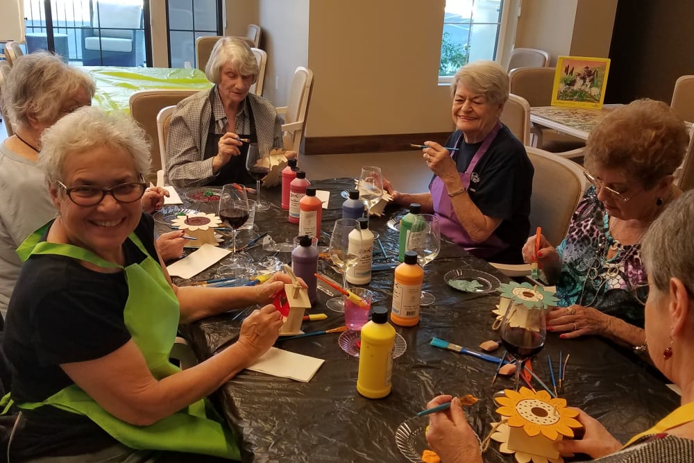Resident friends making crafts at Merrill Gardens at Rancho Cucamonga in Rancho Cucamonga, California.