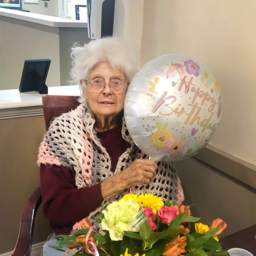 Resident with her birthday gifts at Madison House in Norfolk, Nebraska