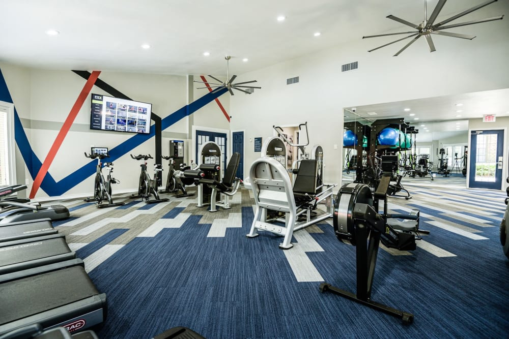 Well equipped fitness center at The Regent in Dallas, Texas