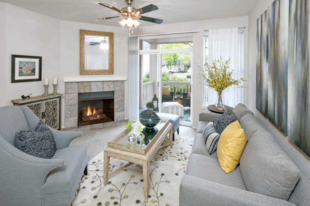 Living room with fireplace at Center Pointe Apartment Homes in Beaverton, Oregon