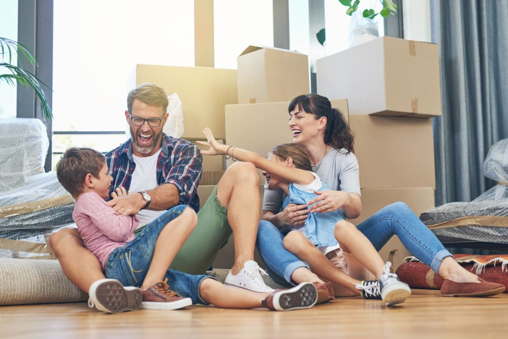 Family Smiling Amidst Moving Boxes