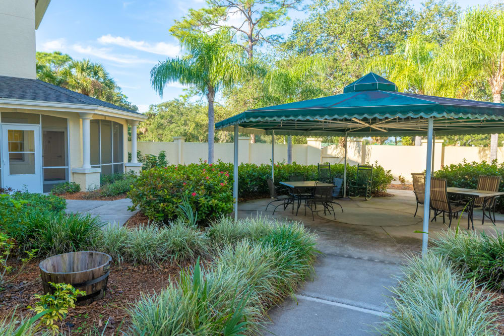 An outdoor, covered seating area at Village Place Senior Living in Port Charlotte, Florida