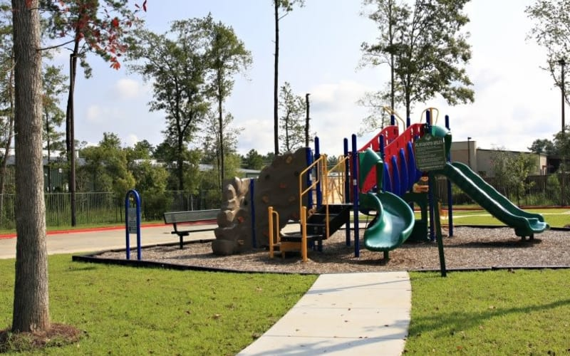 Playground area at Pine Crest Apartment Homes in Covington, Louisiana