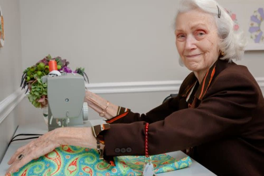 A resident sewing at Mercer Hill at Doylestown in Doylestown, Pennsylvania