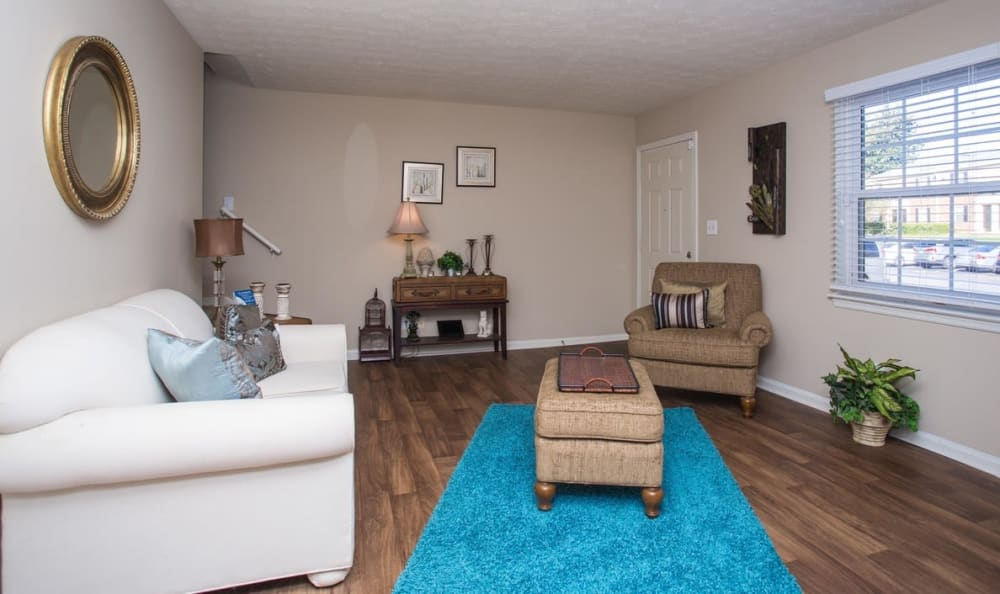 Comfortably decorated living area in a model home at The Arbors at Smyrna in Smyrna, Georgia