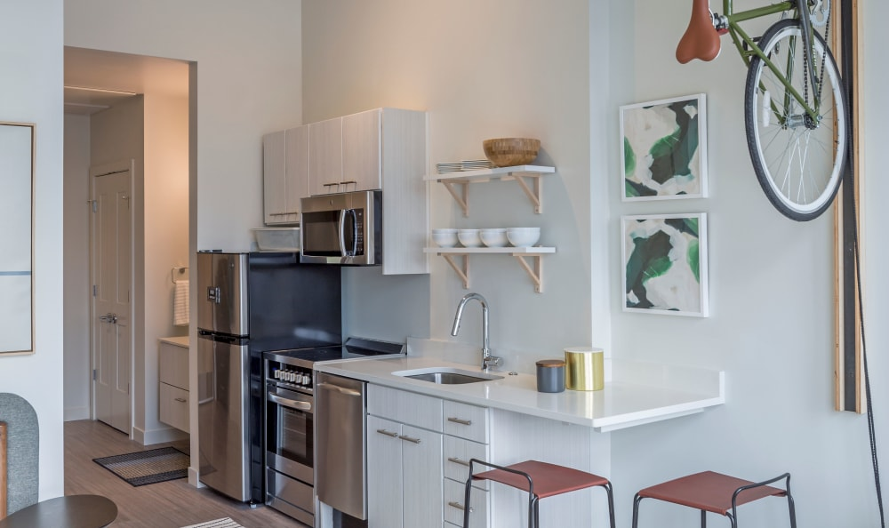 Kitchen with stainless-steel appliances at RiDE at RiNo in Denver, Colorado