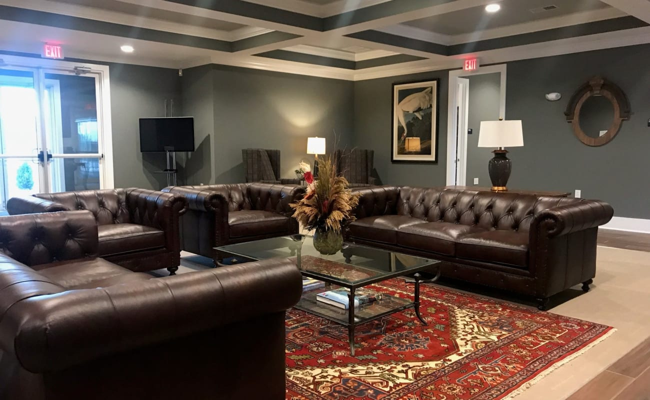 Comfortable seating area in the well-decorated lobby at Bonterra Apartments in Fort Wayne, Indiana
