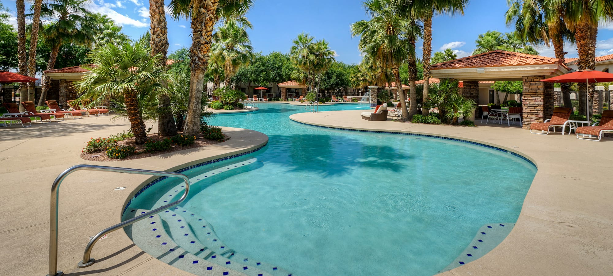 Resort-style swimming pool and water features at San Palacio in Chandler, Arizona