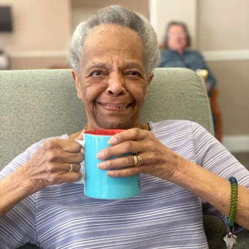 Resident with a cup of tea at FountainBrook in Midwest City, Oklahoma