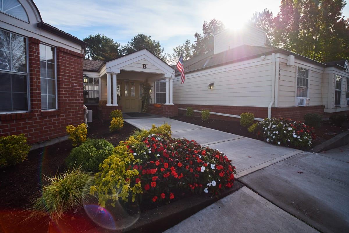 Community entryway with flowers at Farmington Square Beaverton in Beaverton, Oregon