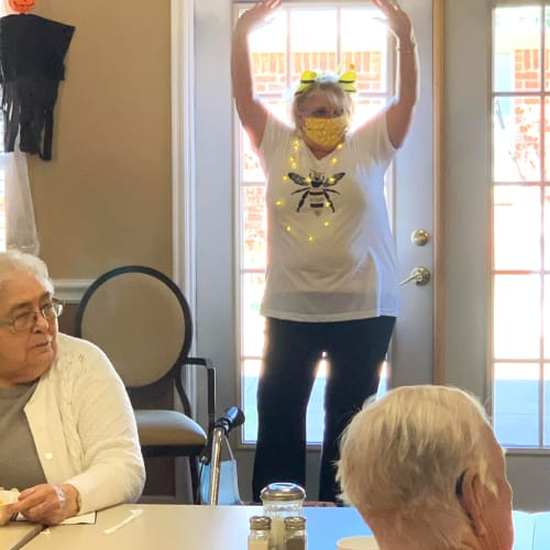 masked caretaker at an event at Canoe Brook Assisted Living in Duncan, Oklahoma