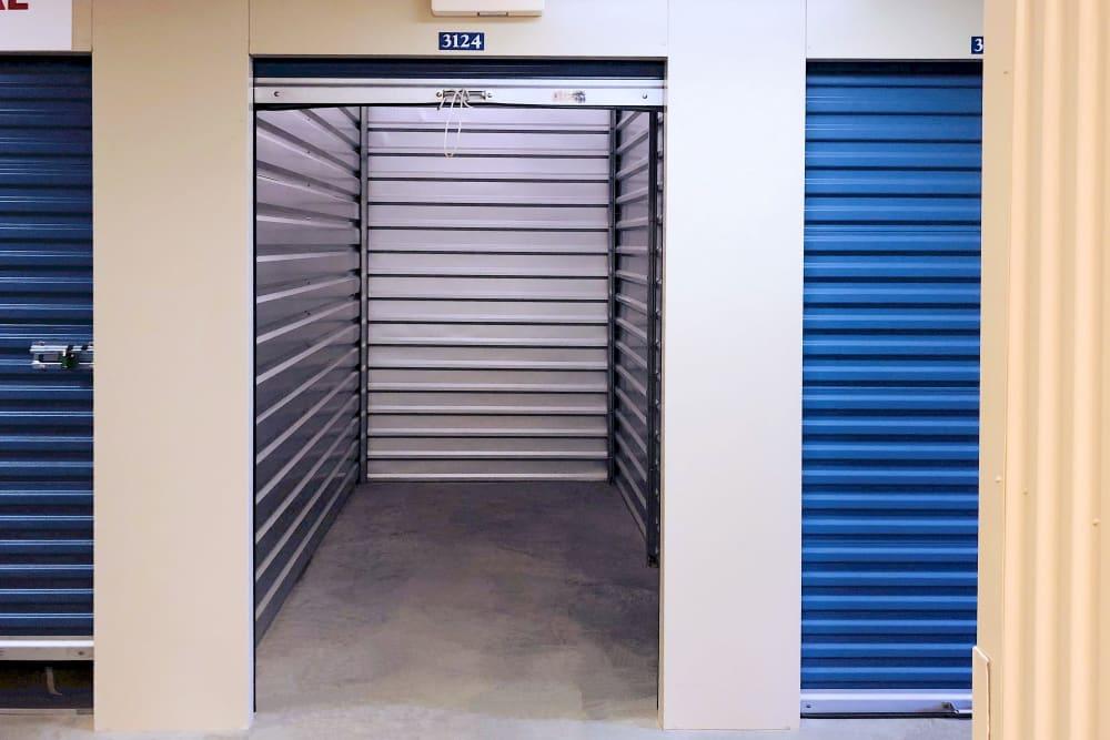 Interior of a indoor storage unit with room up door at Climatrol Self Storage in Williamsburg, Virginia
