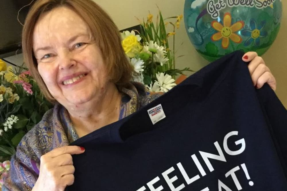 A resident holding a shirt at Wellbrooke of Carmel in Carmel, Indiana