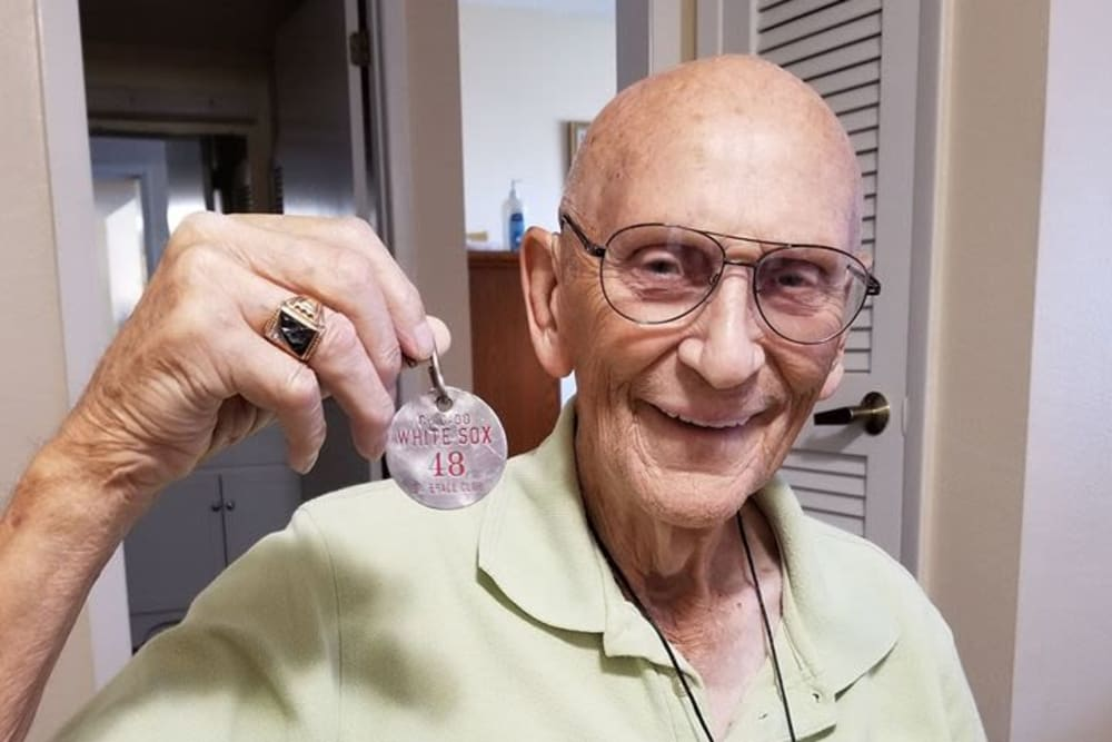 A resident with a medal at Spring Haven in Winter Haven, Florida
