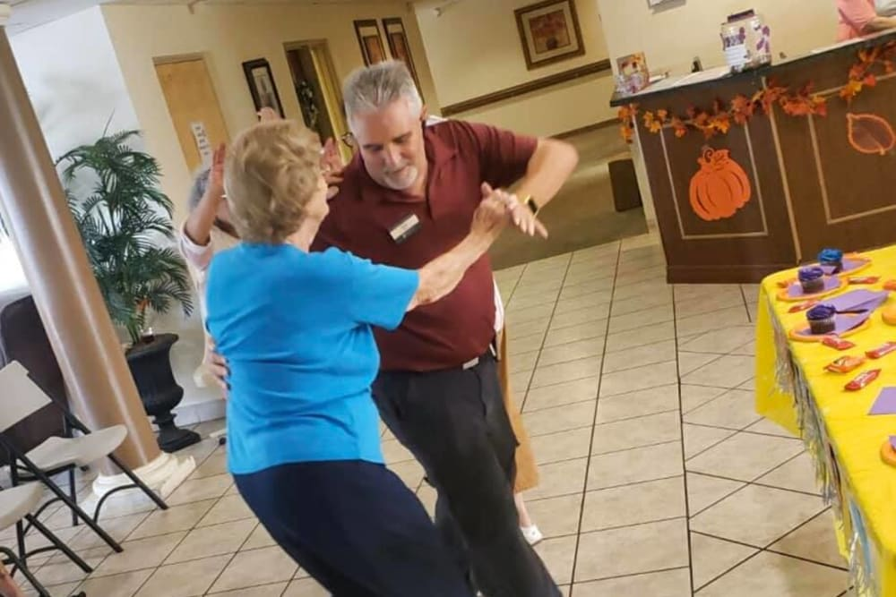 A resident and a staff member dancing at Balmoral Assisted Living in Lake Placid, Florida