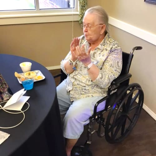 Seated team member eating breakfast at Canoe Brook Assisted Living & Memory Care in Catoosa, Oklahoma