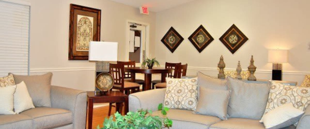 A spacious living room with hardwood floors at Meadow Wood Apartments in Smyrna, Tennessee