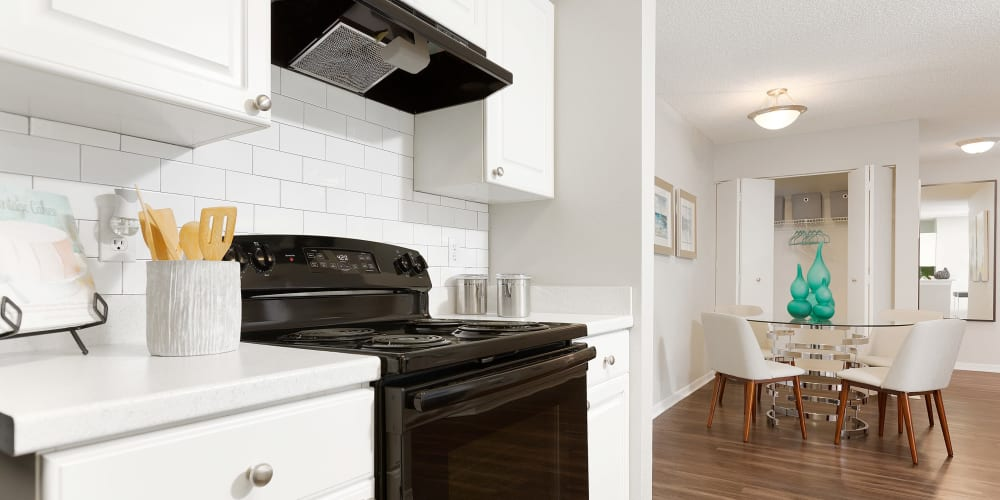 Beautiful white cabinets and wood style flooring at The Avenue in Ocoee, Florida