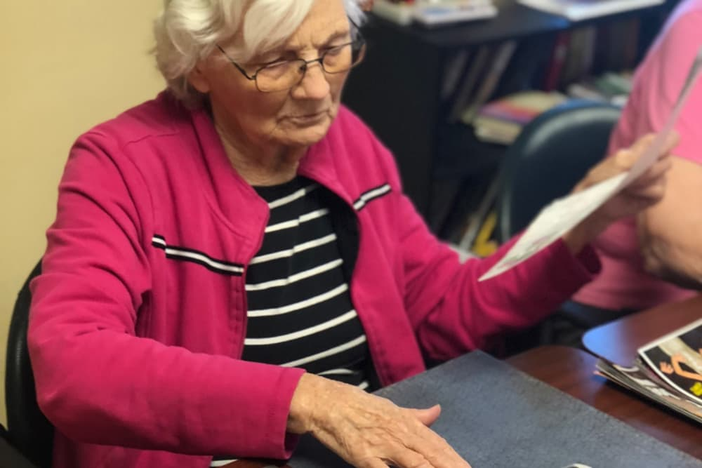 A resident making a collage at Ridgewood Health Campus in Lawrenceburg, Indiana