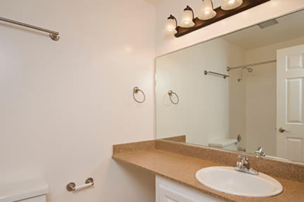 Bathroom with vanity lighting at Flora Condominium Rentals in Walnut Creek, California