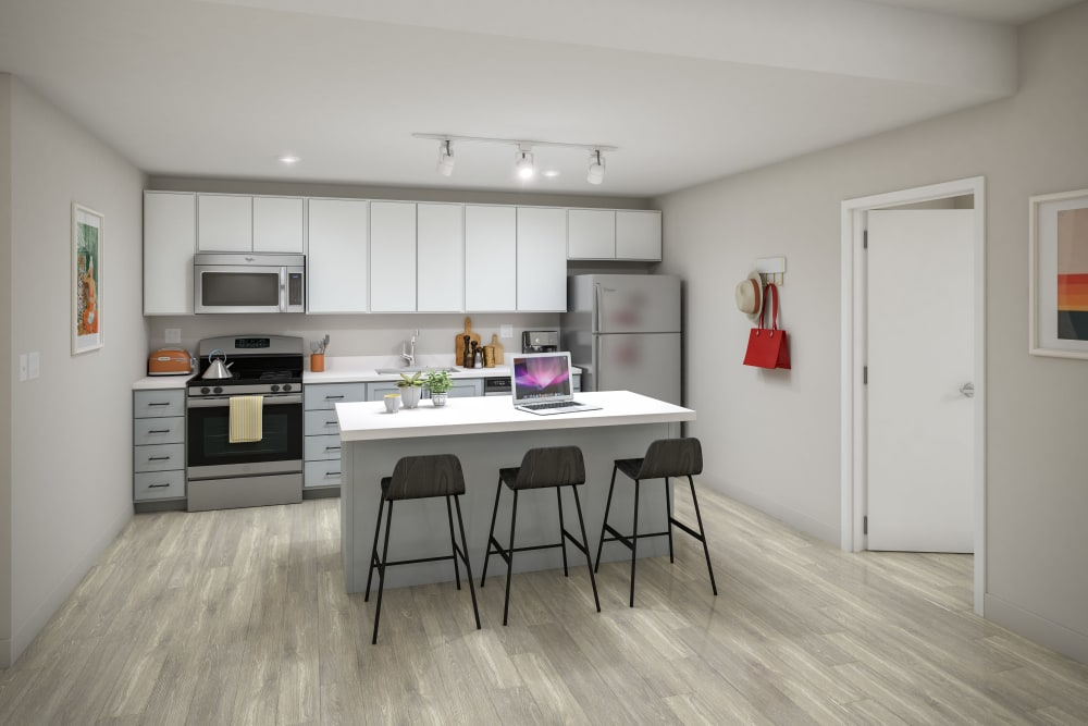 Kitchen with wood style flooring at UNCOMMON Raleigh in Raleigh, North Carolina
