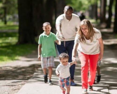 Family walking around Rochester, New York near East Ridge Manor Apartmentsi