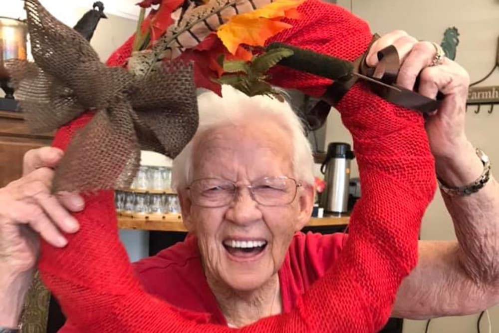 A resident having fun at Villas of Holly Brook Marshall in Marshall, Illinois