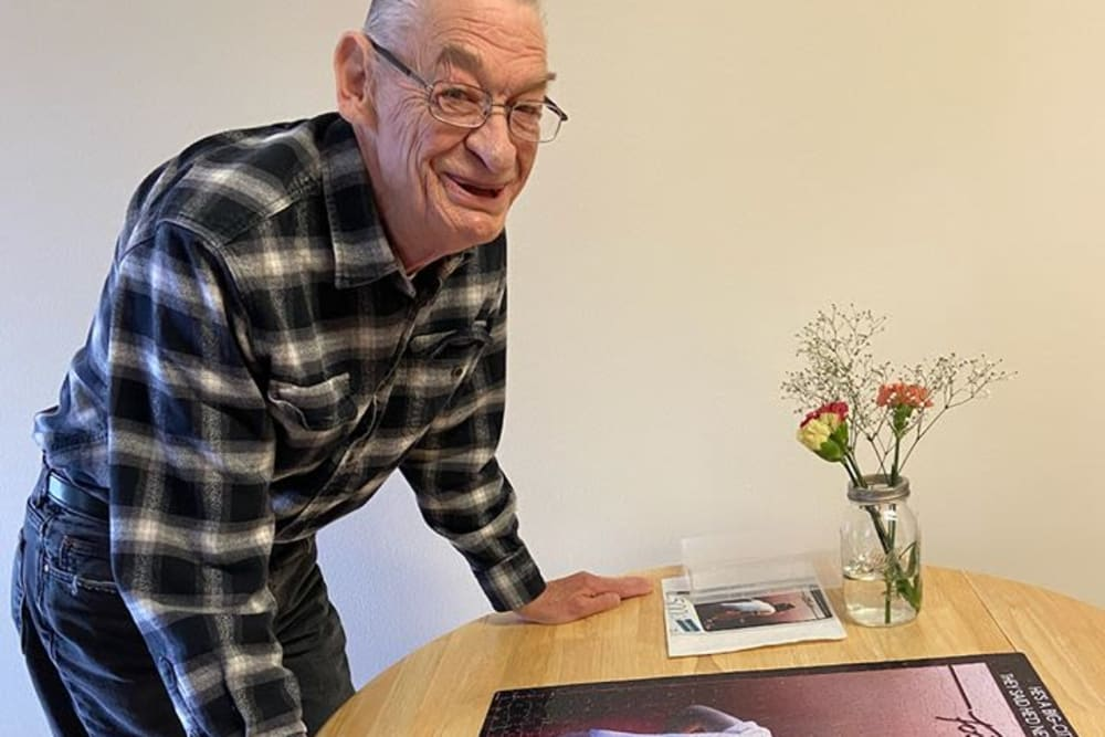 Resident working on puzzle at Victory Centre of Joliet