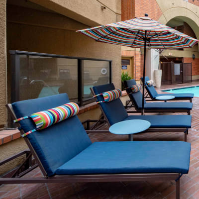 Lounge chairs near the spa at Sofi at 3rd in Long Beach, California