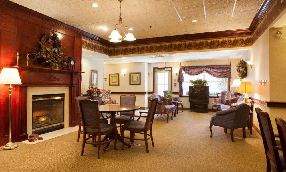 Activity room with a fireplace at Governor's Pointe in Mentor, Ohio