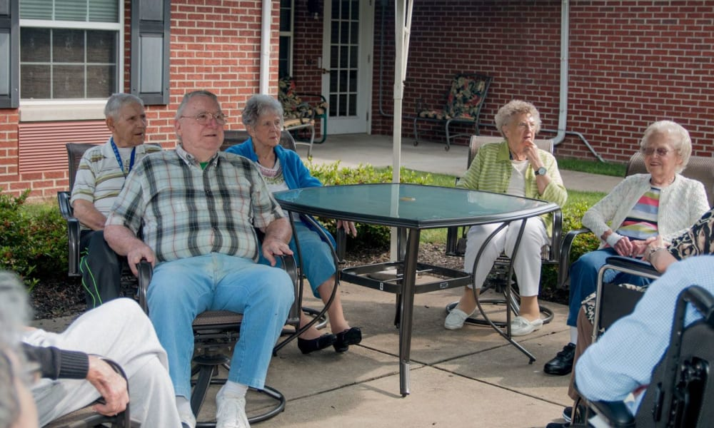 Residents sitting in the shade outside at Governor's Pointe in Mentor, Ohio