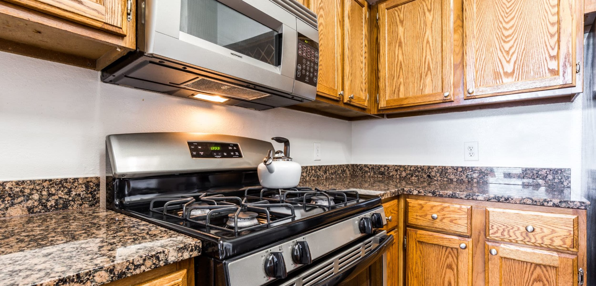 Bright kitchen with modern appliances at Marquis at Caprock Canyon in Austin, Texas