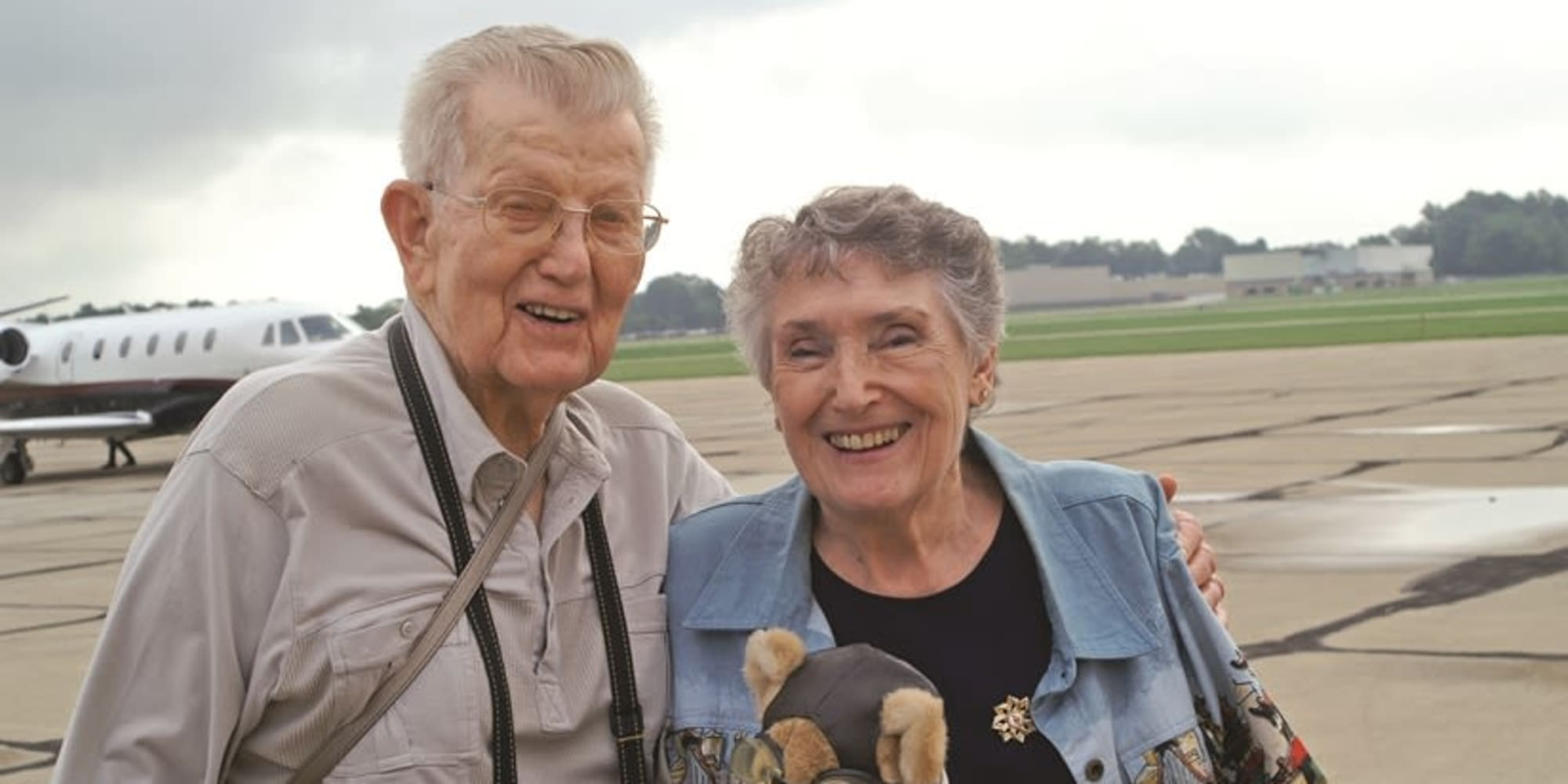 Two residents from Birchwoods at Canco Assisted Living in Portland, Maine in front of a plane