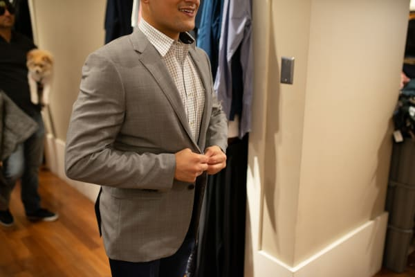 Resident downtown trying on suits near The Astor at Osborn in Phoenix, Arizona