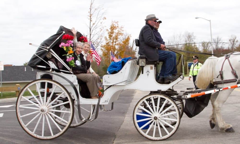 Residents going for a horse-drawn carriage ride near Ashton Gardens Gracious Retirement Living in Portland, Maine