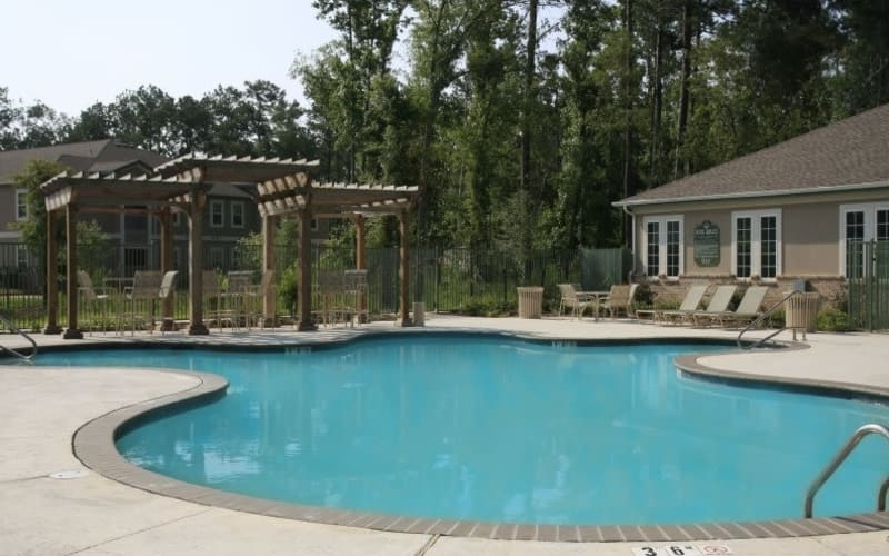 Enjoy a sparkling swimming pool at Pine Crest Apartment Homes in Covington, Louisiana