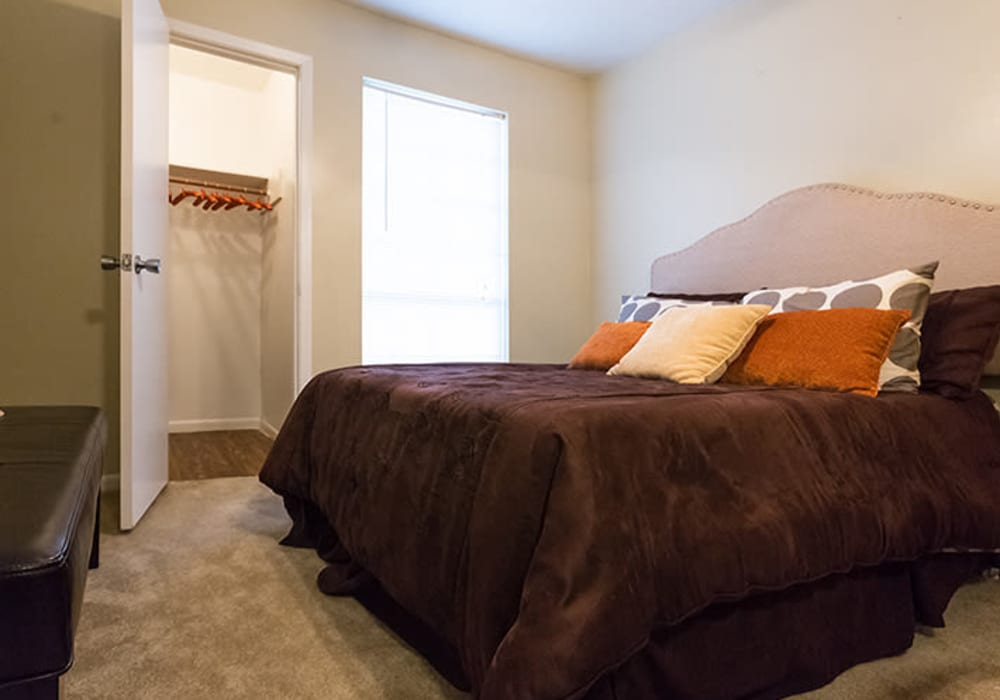 Model bedroom at Riverstone Apartments in Bryan, Texas