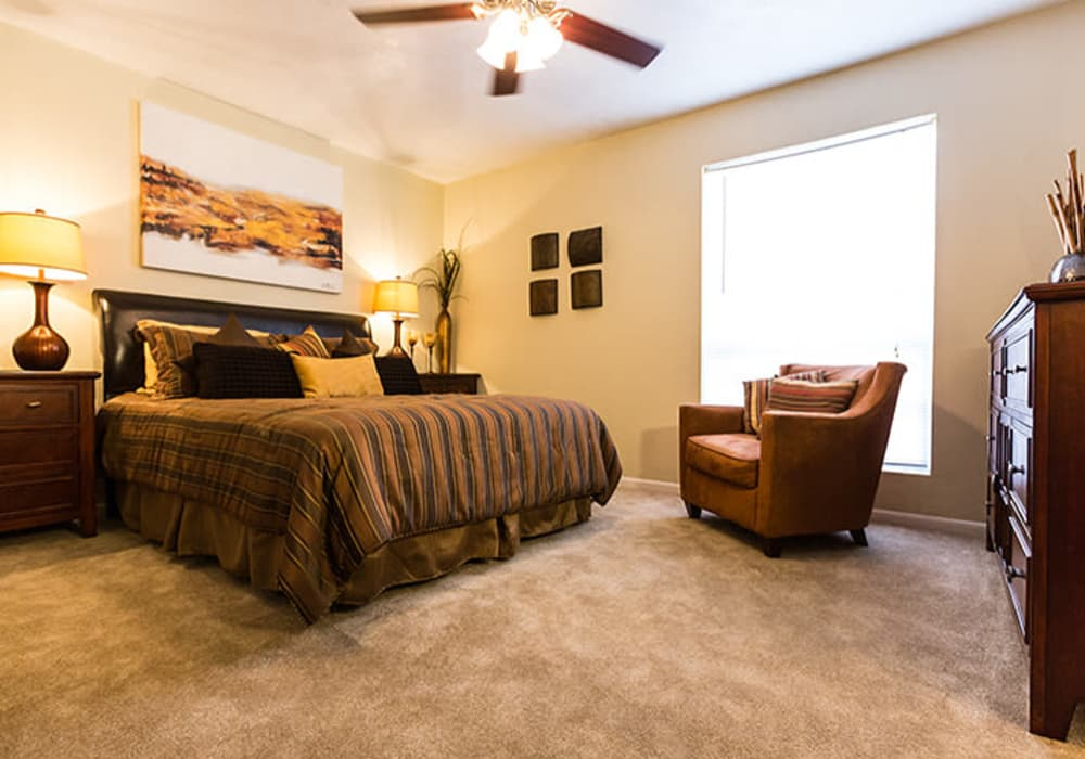 Master bedroom at Riverstone Apartments in Bryan, Texas