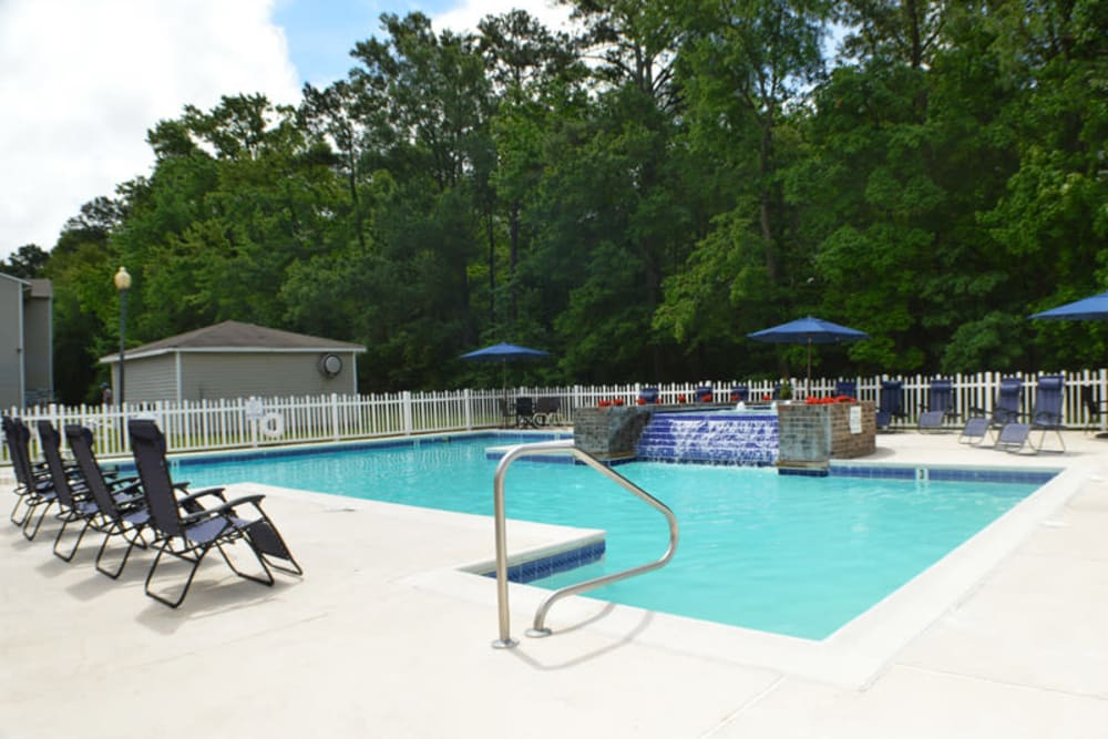 Resort-style swimming pool with a sundeck at Laurel Pines Apartments in Richmond, Virginia