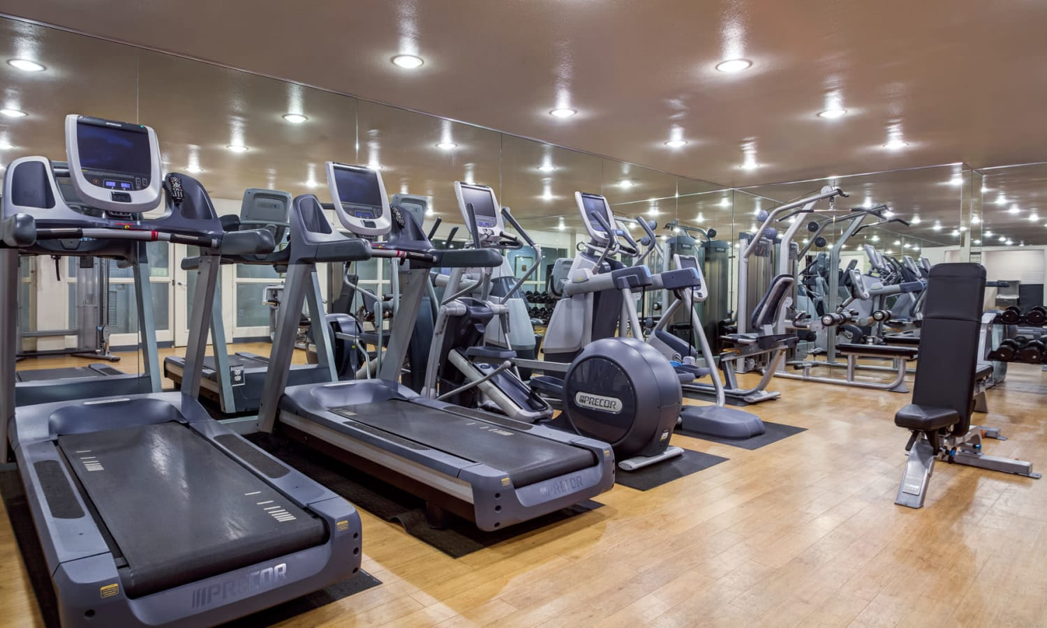 Well-equipped onsite fitness center for resident use at L'Estancia in Studio City, California