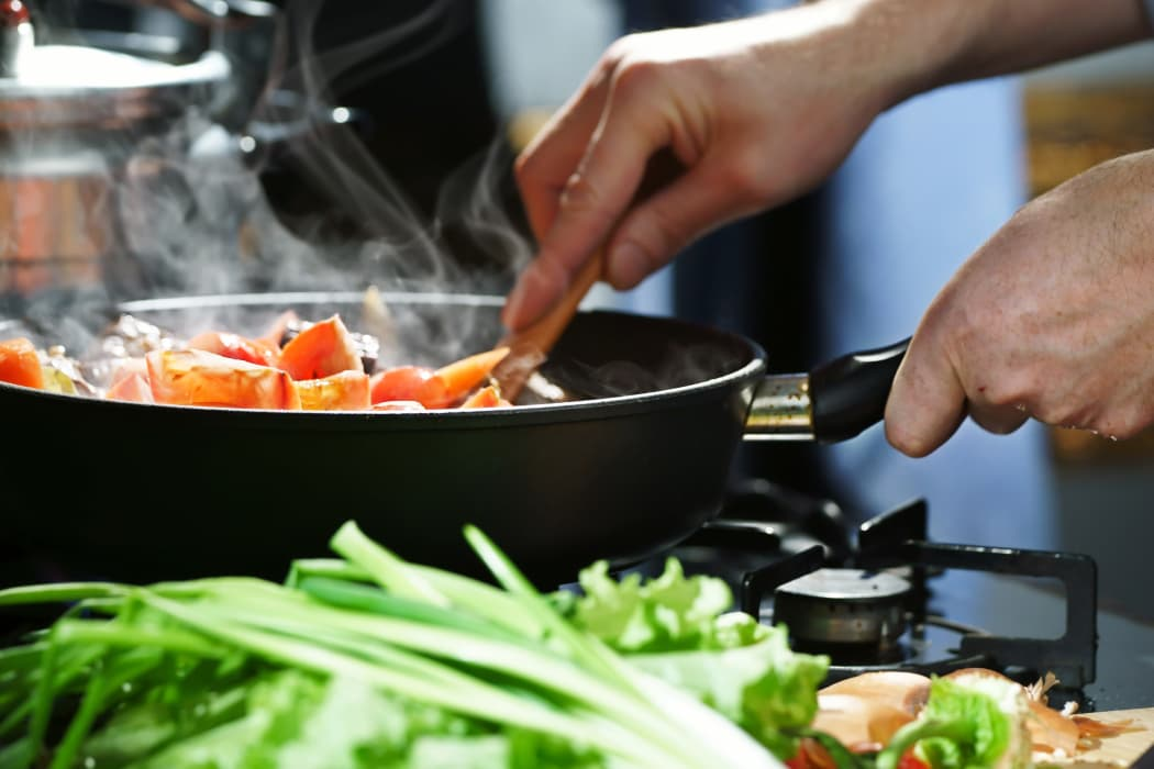 Vegetables cooking in skillet Raintree Apartments in Wichita, Kansas
