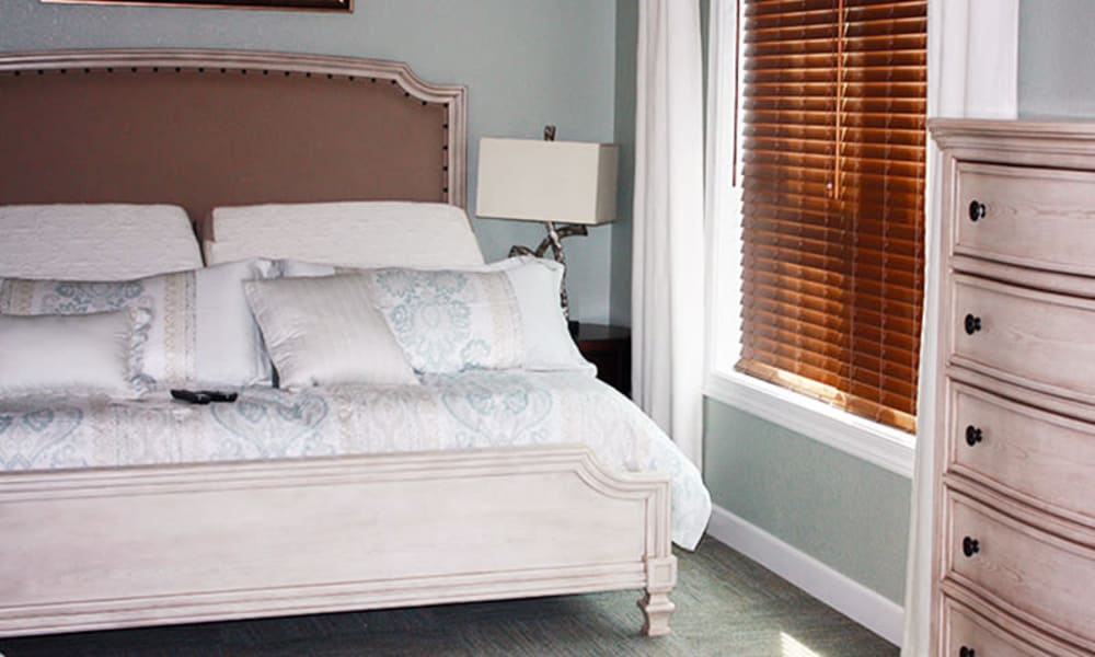 A bedroom with a large window at Water's Edge in Mankato, Minnesota
