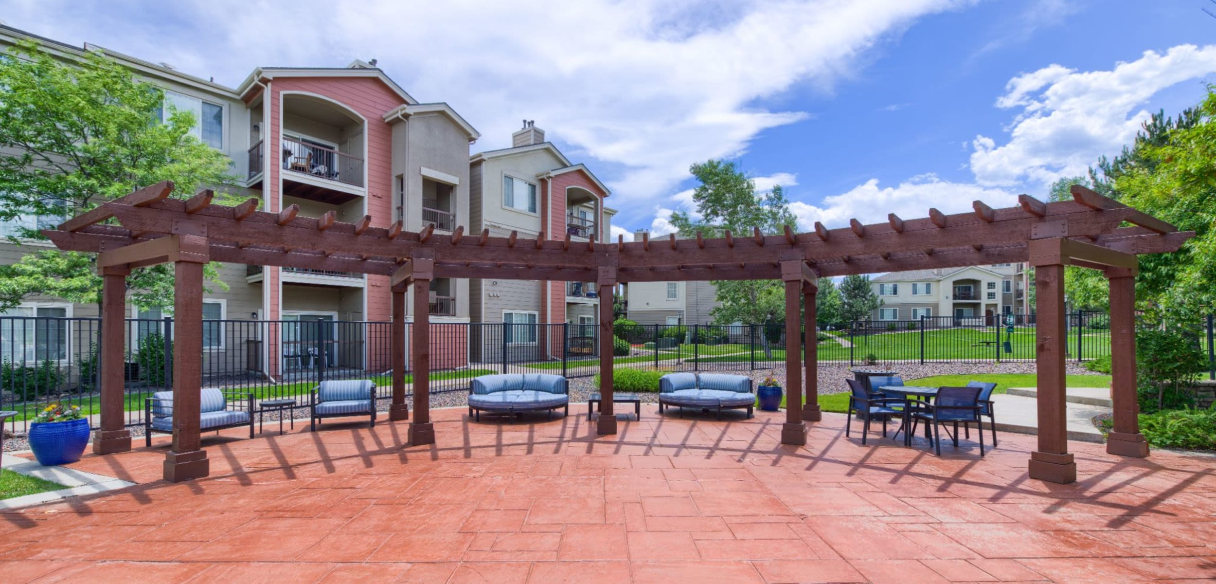Row of patio furniture at Whisper Creek Apartment Homes in Lakewood Colorado,